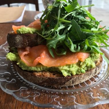 Avo on organic sourdough & rye toast + smoked salmon + wild rocket