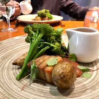KELMSCOTT PORK BELLY & FILLET Jersey royals & purple sprouting broccoli. Spiced rhubarb.