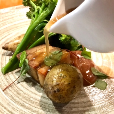 KELMSCOTT PORK BELLY & FILLET Jersey royals & purple sprouting broccoli. Spiced rhubarb.
