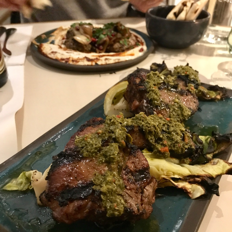 lamb chops marinated in kabsa spices & plums then grilled, charcoaled hispi cabbage, vine leaves chimichurri