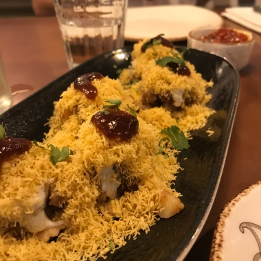Papri Chaat [vegetarian] spiced potatoes and black chickpeas on a wheat cracker with tamarind chutney