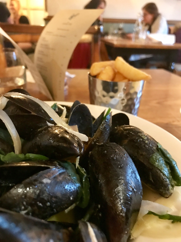 Steamed Elberry Cove mussels, white wine, garlic cream, chips