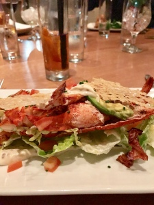half freshly prepared lobster. Crispy bacon. Parmesan crisp. Avocado Caesar (£7 surcharge)