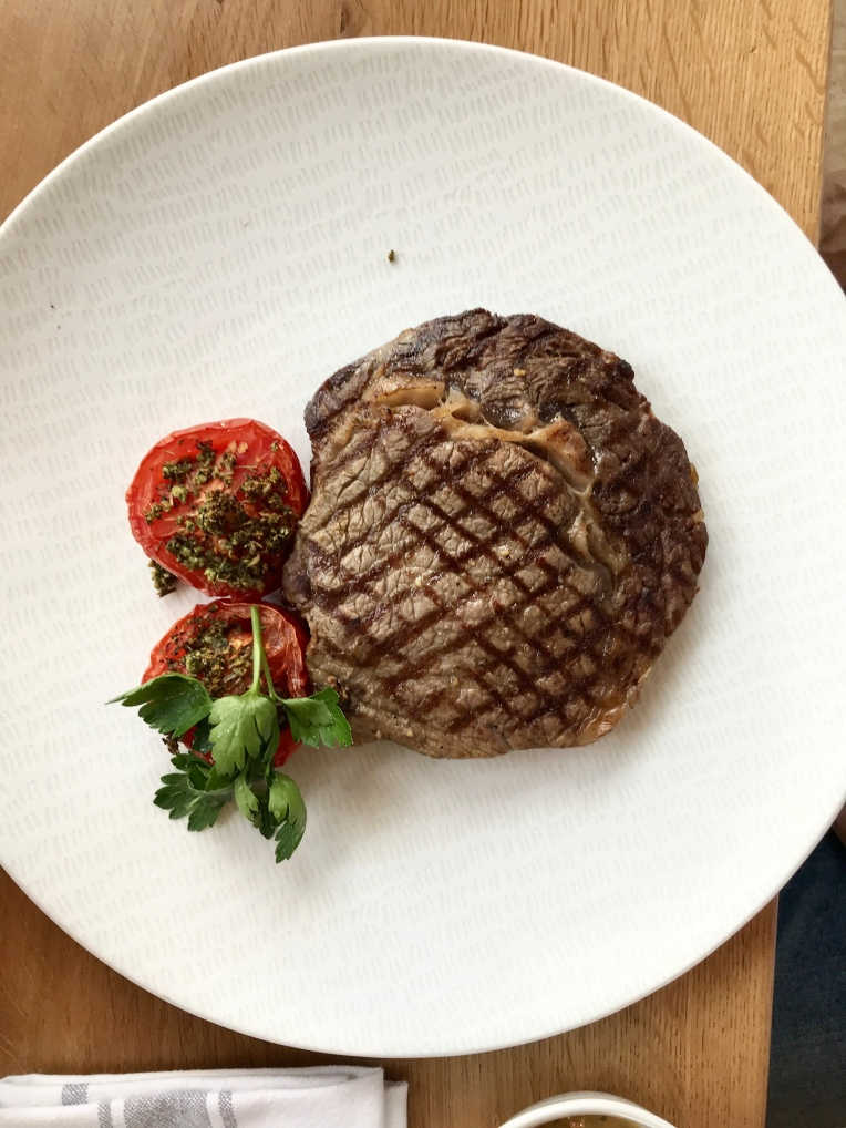 Grilled Ribeye steak with French fries & provencal tomato, Foyot sauce
