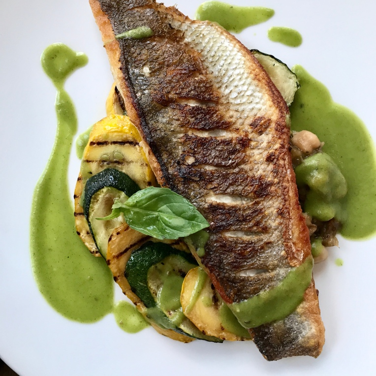sea bass with aubergine caviar & courgette, basil sauce