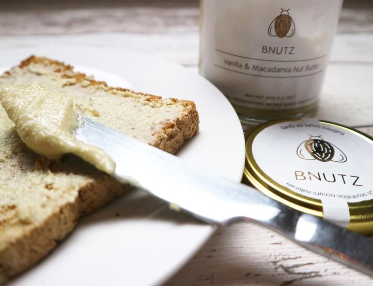 Vanilla and Macadamia Nut Butter spread onto brown toast