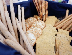 Different crackers including bread sticks in a box