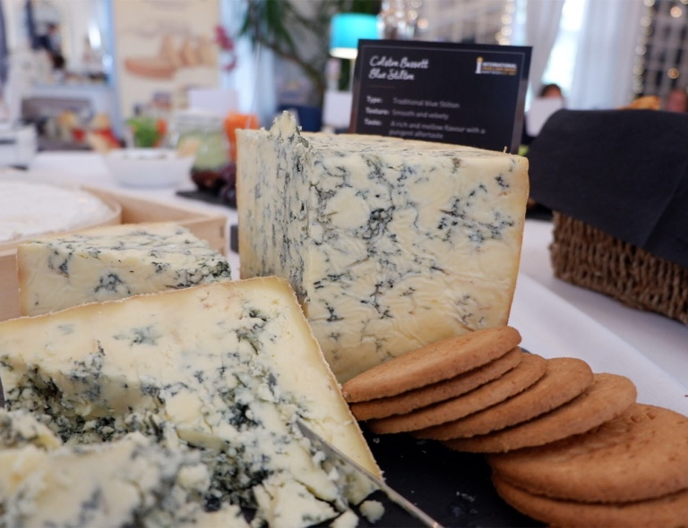 Blocks of Colston Bassett Blue Stilton with digestive biscuits