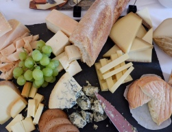 A flat lay of many different cheeses