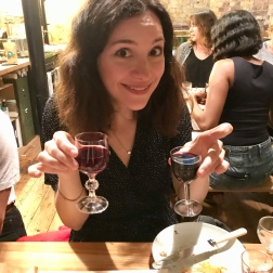 Claire holding two small glasses of vegan red wine - Cheers!