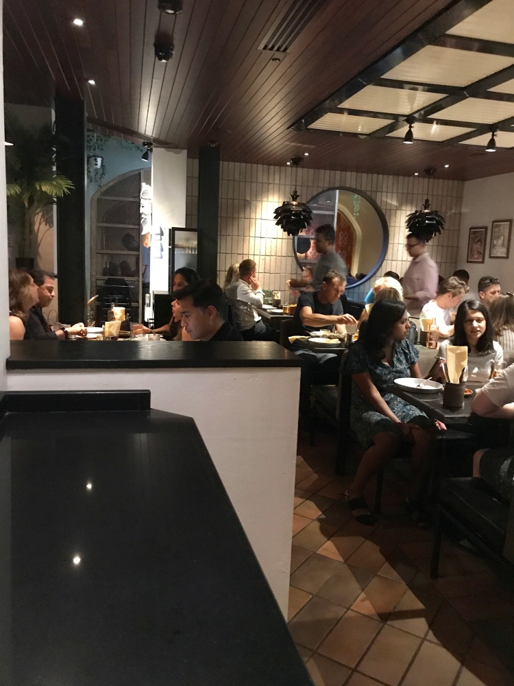 Downstairs in Hoppers Marylebone, packed full of customers