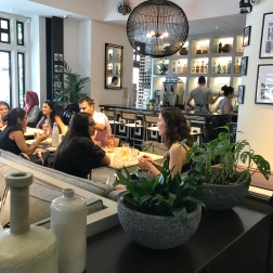 Customers chattering away in a busy restaurant