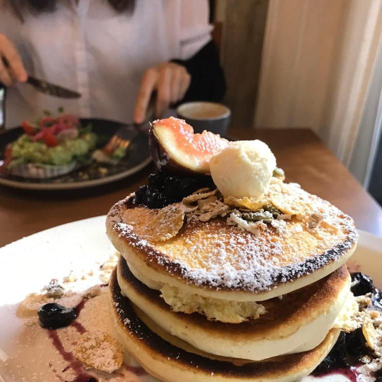 Wholemeal Pancakes stacked up with half a fig as decoration